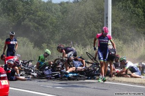 Riders and their bicycles fill the road after a fall during the 159,5 km (99 miles) third stage of the 102nd Tour de France cycling race from Anvers to Huy, Belgium, July 6, 2015. REUTERS/Eric Gaillard - RTX1J8WN